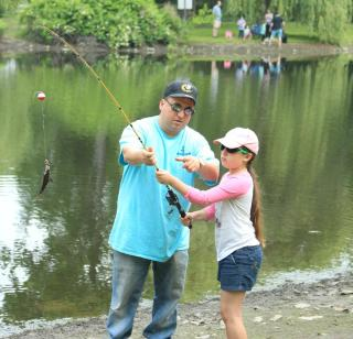 Man helping girl to fish
