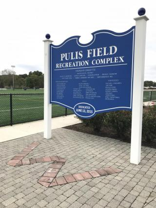 Royal Blue sign with the words Pulis Field Recreation Complex, listing donors to the project